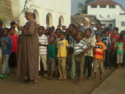 "Teacher with chanting ""Al-badiri"" with students"
